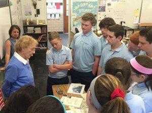 Survivor Anneliese Nossbaum sharing her artifacts with students