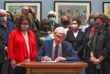 Gov. Evers signs Senate Bill 69 on April 28 at the Milwaukee Jewish Federation.